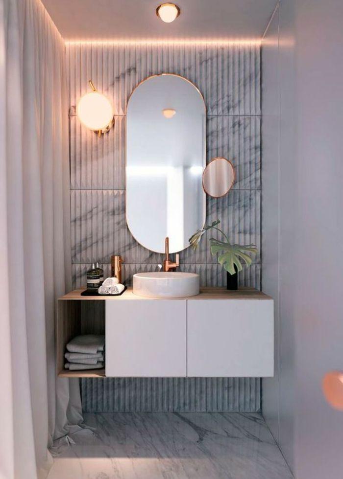 id e d coration salle de bain miroir lumineux salle de bain en forme ovale avec un petit. Black Bedroom Furniture Sets. Home Design Ideas