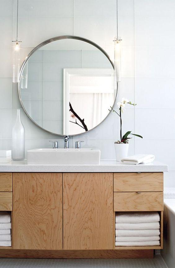 Idée décoration Salle de bain pourquoi avoir un miroir rond dans