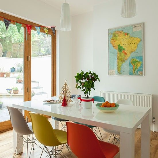 Modern White Dining Room Sets: Modern White Dining Room With Multi-coloured Chairs