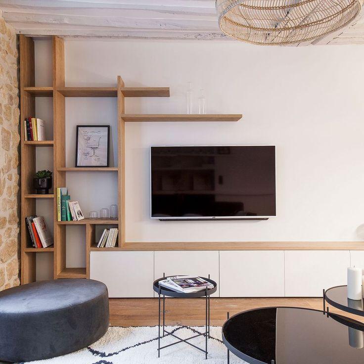 Déco Salon - Une bibliothèque en bois massif disparaît dans ...